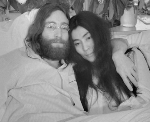 "June 1969, Montreal, Quebec, Canada --- Original caption: Yoko and John...Beatle John Lennon and Yoko Ono, his bride of three months at the time this photo was made in Montreal in June 1969, pose in bed. His first solo album at the time featured songs telling of his love for Yoko. They held, in bed, press conferences in several cities with the theme, ""make love, not war."" Lennon was shot to death December 8, 1980. In a statement December 9th, Miss Ono said, ""There is no funeral for John. Later in the week we will set the time for silent vigil to pray for his soul. We invite you to participate from wherever you are at the time."" --- Image by © Bettmann/CORBIS"