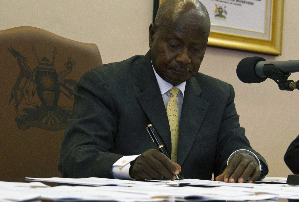 Ugandas President Yoweri Museveni signs the Anti-Homosexuality Bill on February 24, 2014 in Entebbe. The bill that was first tabled back in 2009 will see offenders, when convicted, serve a life imprisonment. President Museveni went ahead to say that he wont let Uganda citizens be forced into such behaviours by the Western Society.