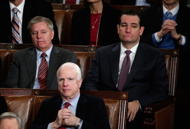 WASHINGTON, DC - JANUARY 28:  (L-R) U.S. Sen. Lindsey Graham (R-SC), U.S. Sen. John McCain (R-AZ) and U.S. Sen. Ted Cruz (R-TX) listen as U.S. President Barack Obama delivers the State of the Union address to a joint session of Congress in the House Chamber at the U.S. Capitol on January 28, 2014 in Washington, DC. In his fifth State of the Union address, Obama is expected to emphasize on healthcare, economic fairness and new initiatives designed to stimulate the U.S. economy with bipartisan cooperation.  (Photo by Win McNamee/Getty Images)