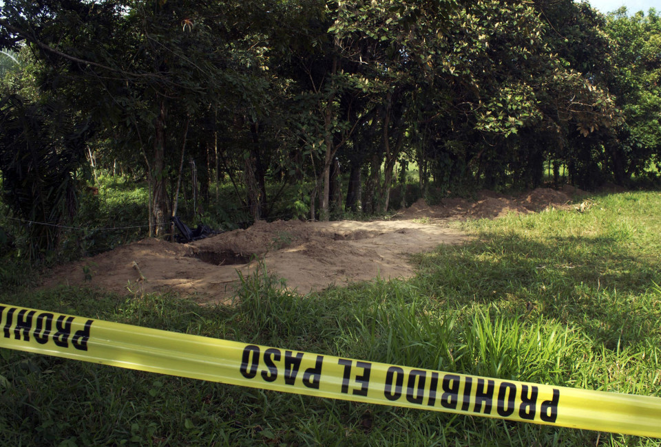 View at Diamante ranch in Nopaltepec, Veracruz state, Mexico on, June 18, 2014, where the bodies of at least 28 people have been exhumed from a mass grave. The bodies were found by members of an army patrol at an abandoned ranch in Veracruz --a stronghold of the Zetas, one of Mexico's most bloodthirsty cartels.     AFP PHOTO        (Photo credit should read STR/AFP/Getty Images)