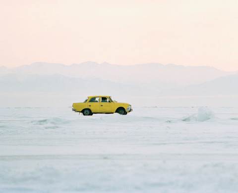 A car driving over the frozen Lake Baikal in Siberia, Russia --- Image by © Philip Lee Harvey/Corbis