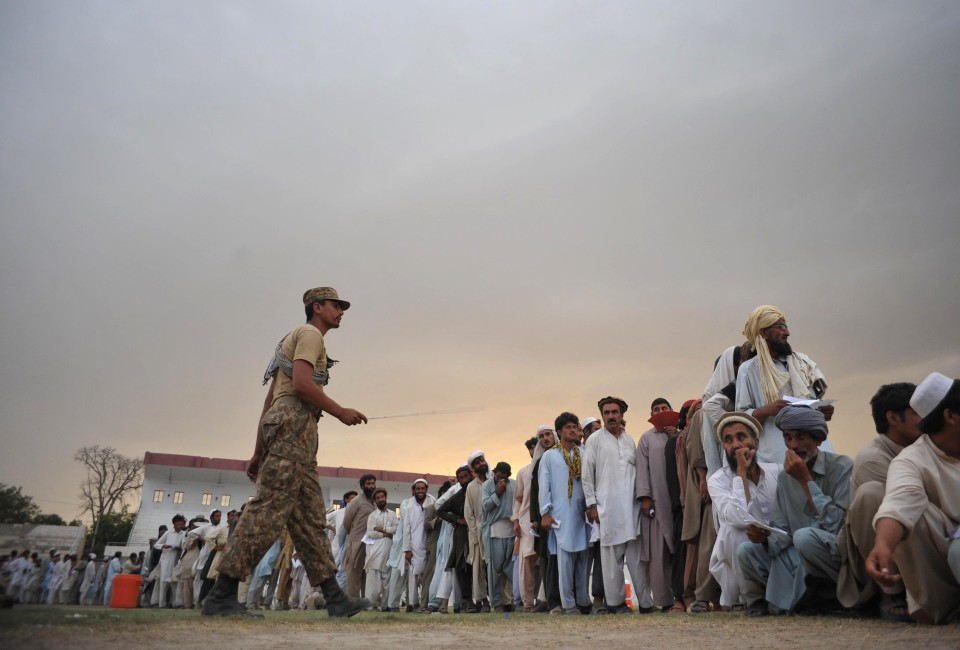 Internally displaced Pakistanis, fleeing a military operation in the North Waziristan tribal agency, wait for food supplies at the World Food Programme aid distribution centre in Bannu on June 25, 2014. The World Food Programme on June 23 began distributing aid for hundreds of thousands of people who have fled a military operation in Pakistan, but there was anger among refugees at long delays. AFP PHOTO/Hasham AHMED        (Photo credit should read HASHAM AHMED/AFP/Getty Images)