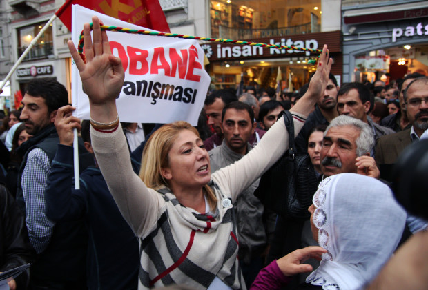 """ANKARA, TURKEY - 2014/10/11: Demonstrators protest against the Turkish government's policy on Islamic State (IS) on Istıklal street in Istanbul. Demonstrators shouted slogan: """"Everywhere is Kobane, everywhere is resistance"""". (Photo by Basin Foto Ajansi/LightRocket via Getty Images)"""
