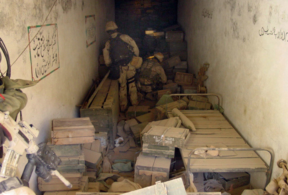 020114-N-8242C-004   Eastern Afghanistan (January 14, 2002) -- During a search and destroy mission, U.S. Navy SEALs discover a large cache of munitions in one of more than 50 caves explored in the Zhawar Kili area. Used by al-Qaeda and Taliban forces, the caves and above-ground complexes were subsequently destroyed through air strikes called in by the SEALs.  Navy special operations forces are conducting missions in Afghanistan in support of Operation Enduring Freedom. U.S. Navy photo (RELEASED)