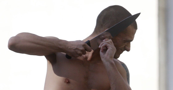 Artist Slices Off Own Earlobe to Protest Putin's Politics