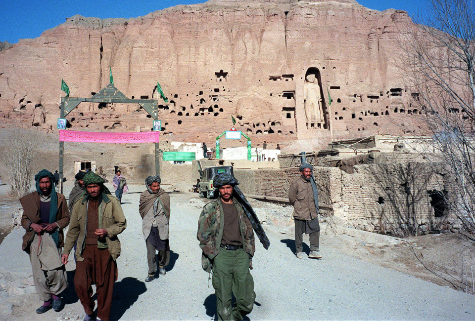 "A filer picture dated 07 December 1997 shows soldiers belonging to Shiite faction Hizb-i-Wahdat on patrol in front of a hill with the ancient Bhuddha Statue in Bamiyan province of Afghanistan. Afghan Foreign Minister Wakil Ahmad Mutawakel insisted 08 March 2001 that a decree by the Taliban's supreme leader, Mullah Mohammad Omar, ordering the total destruction of all statues in the country was ""irreversible."" (FILM) AFP PHOTO/ Jean-Claude CHAPON (Photo credit should read JEAN-CLAUDE CHAPON/AFP/Getty Images)"