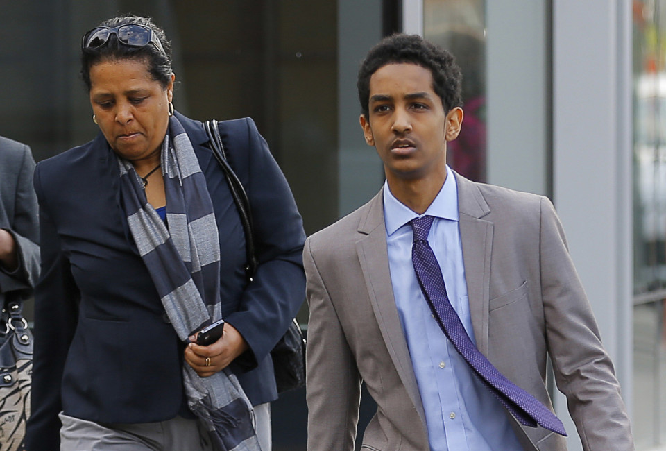 Robel Phillipos (R), a friend of accused Boston Marathon bomber Dzhokhar Tsarnaev who is charged with lying to investigators, arrives for a hearing in his case at the federal courthouse in Boston, Massachusetts May 13, 2014. Lawyers for three friends of the accused Boston Marathon bomber charged with hampering the investigation into the deadly 2013 blasts are in court on Tuesday to ask a judge to dismiss the charges or move their upcoming trial out of town. REUTERS/Brian Snyder (UNITED STATES - Tags: CRIME LAW) - RTR3OXPD