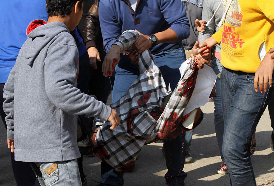 Egyptians carry a man who was shot in Cairo's working class district of Matariya during clashes between Islamist protestors and police, health and security officials said on November 28, 2014. The army and police had fanned out across Cairo and other cities in anticipation of rallies called by an Islamist group that opposes the military's overthrow of president Mohamed Morsi last year.  AFP PHOTO / KHALED KAMEL        (Photo credit should read KHALED KAMEL/AFP/Getty Images)