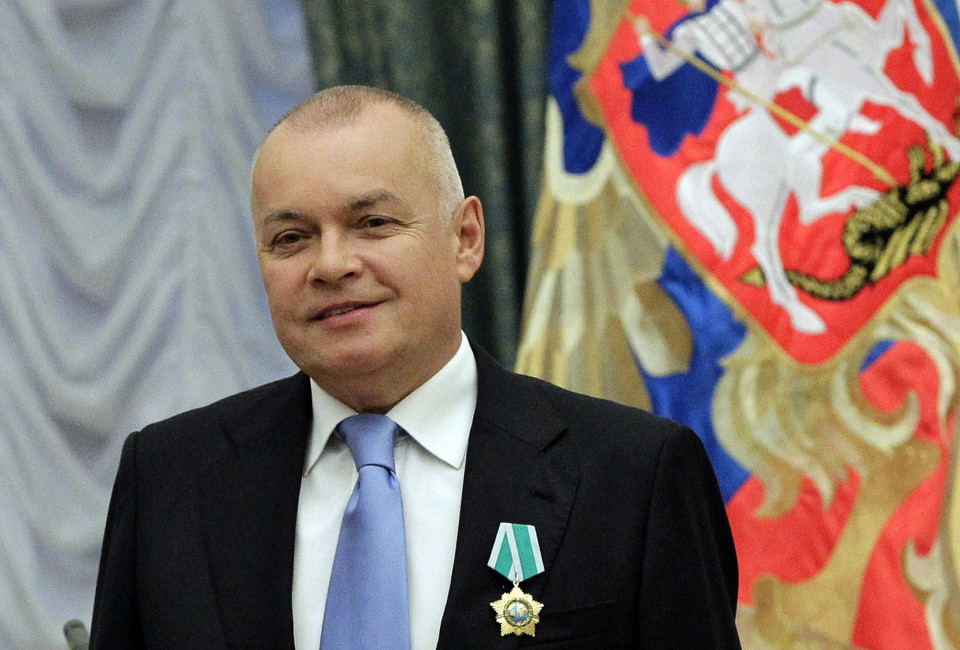 A picture taken on October 10, 2011, shows Russian television journalist Dmitry Kiselyov posing for a photo after receiving a medal of Friendship  during an awarding ceremony in the Kremlin in Moscow. Russian President Vladimir Putin signed today a decree dissolving Russia's biggest news agency, RIA Novosti , ordering the creation in its place of a new media conglomerate Rossiya Segodnya (Russia Today). Putin named today Dmitry Kiselyov as the head of Russia Today.  AFP PHOTO/ RIA-NOVOSTI/ POOL/  MIKHAIL KLIMENTYEV        (Photo credit should read MIKHAIL KLIMENTYEV/AFP/Getty Images)