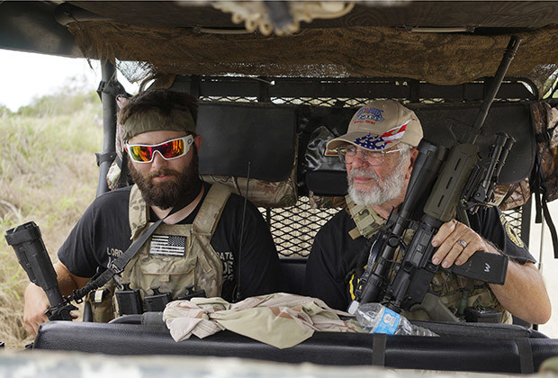 "Members of the ""Patriots"" Huggie Bear (L, not his real name), Ray (C, no last name given) and Will (R, no last name given) patrol in their UTV near a camp of patriots near the U.S.-Mexico border outside Brownsville, Texas September 2, 2014. Huggie Bear, 25, is a former sergeant in the Army, Ray served six years in the Coast Guard and Will is a construction worker. The ""Patriots"" are a heavily armed group who patrol the U.S. border with Mexico, trying to deter immigrants from crossing the border illegally. The group, who portray themselves as defending the American way, use a strong display of force to intimidate anyone from making the crossing from Mexico into Texas. To critics, they are vigilantes spoiling for a fight. To the immigrants, they are another barrier to entry and to the U.S. Border Patrol, groups like this can either be a nuisance interfering with their operations or an aide in spotting migrants illegally trying to enter the country.  Picture taken September 2, 2014.  REUTERS/Rick Wilking (UNITED STATES - Tags: POLITICS SOCIETY IMMIGRATION MILITARY TPX IMAGES OF THE DAY CRIME LAW)  ATTENTION EDITORS: PICTURE 05 OF 20 FOR WIDER IMAGE PACKAGE 'DEFENDING THE AMERICAN WAY'. TO FIND ALL IMAGES SEARCH 'BROWNSVILLE WILKING' (POLITICS SOCIETY IMMIGRATION) - RTR45ND4"