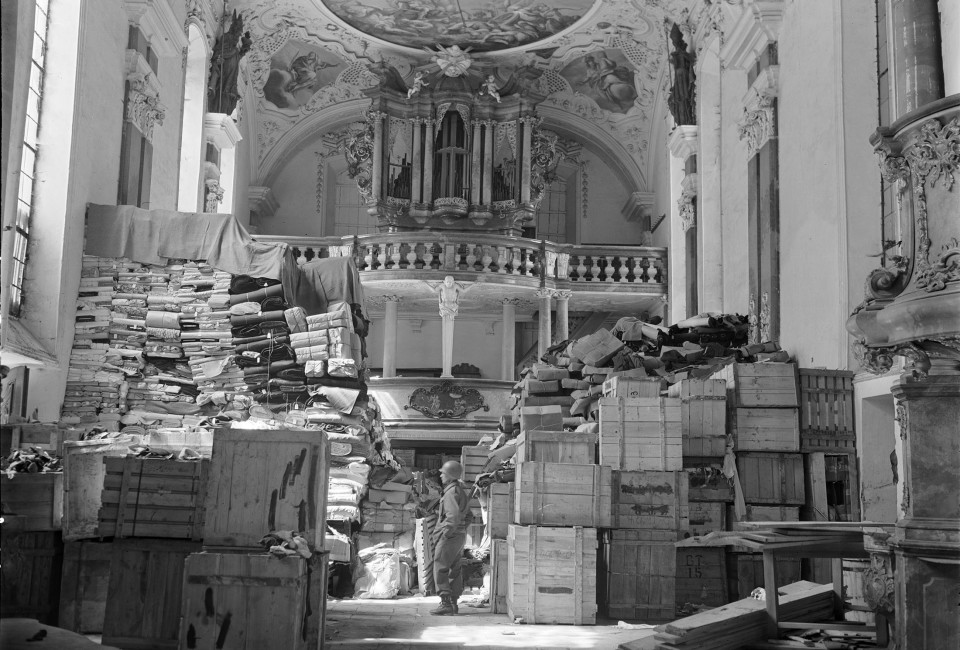 A U.S. soldier views art stolen by the Nazi regime and stored in a church at Ellingen, Germany April 24, 1945. A vast trove of modern art seized under Germany's Nazi regime, including works by Picasso, Matisse and Chagall, has been discovered in a Munich apartment among stacks of rotting groceries, German magazine Focus reported. The 1,500 art works, missing for more than 70 years, and discovered by chance by customs authorities in the southern German state of Bavaria in 2011, could be worth well over 1 billion euros ($1.35 billion), Focus said. The artworks shown in the picture are not those discovered in the Munich apartment in 2011.