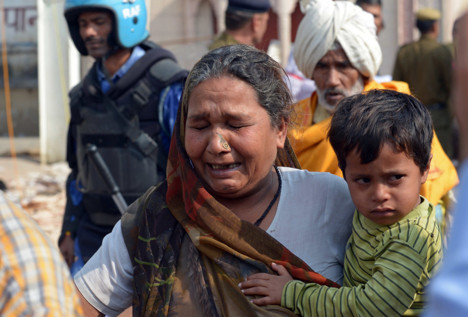 A follower of self-styled 'godman' Rampal Maharaj cries as she leaves the ashram at Barwala in the district of Hisar, some 175 kilometres (108 miles) north of New Delhi on November 20, 2014. Indian police were scouring the ashram of a controversial guru for explosives after his arrest ended a bloody stand-off with thousands of followers and a long siege during which six people died. AFP PHOTO/SAJJAD HUSSAIN        (Photo credit should read SAJJAD HUSSAIN/AFP/Getty Images)