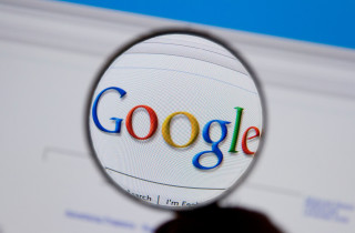 B5HKDF A magnifying glass highlights the Google search engine on a computer screen.. Image shot 11/2008. Exact date unknown.