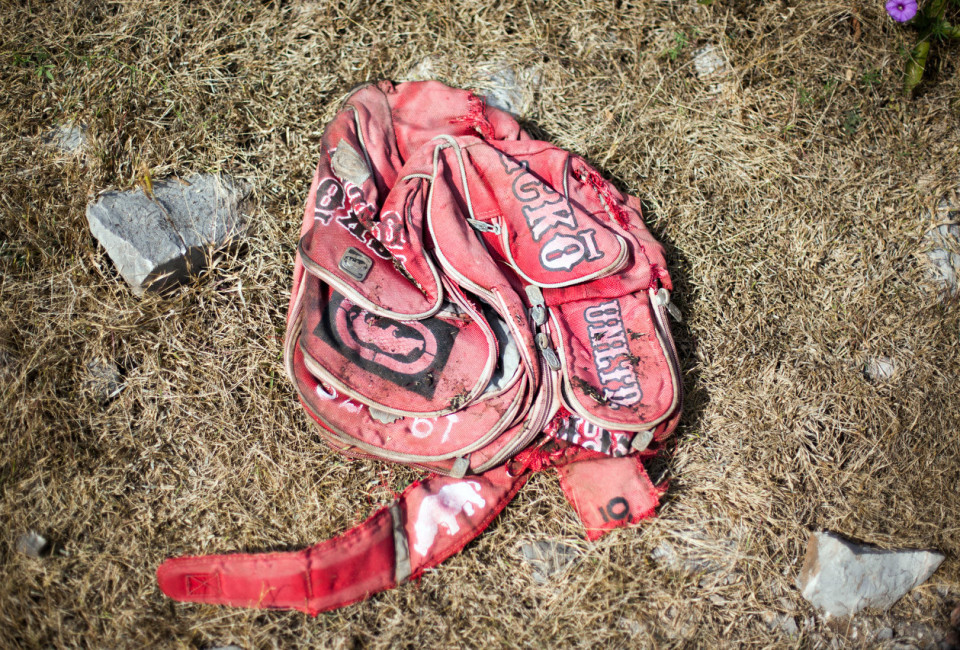 Iguala, Guerrero, Mexico- A disgraced backpack found, as family members of missing people search the mountains surrounding the city of Iguala for clandestine graves, Iguala, Guerrero, Mexico, November 29, 2014. Trash often alerts searches to potential gravesite. Iguala is the location where 43 students were allegedly kidnapped by local police and handed over to the local cartel Guerreros Unidos. Through searches for the students, many mass graves have been found in the rural mountains in the area.  Photo Brett Gundlock