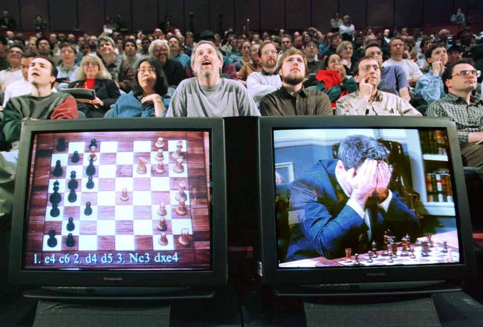 World chess champion Garry Kasparov rests his head in his hands as he is seen on a monitor during game six of the chess match against IBM supercomputer Deep Blue , May 11, 1997. The supercomputer made chess history Sunday when it defeated Kasparov for an overall victory in their six game re-match, the first time a computer has triumphed over a reigning world champion in a classical match. Kasparov resigned after 19 moves.  REUTERS/Peter Morgan - RTXHIOM