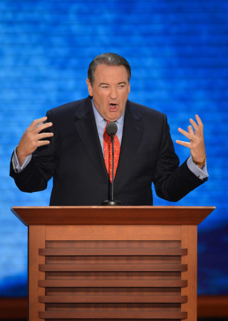 Former presidential candidate Mike Huckabee addresses the audience at the Tampa Bay Times Forum in Tampa, Florida, on August 29, 2012 during the Republican National Convention (RNC). The RNC will culminate on August 30th with the formal nomination of Mitt Romney and Paul Ryan as the GOP presidential and vice-presidential candidates in the US presidential election.    AFP PHOTO Stan HONDA        (Photo credit should read STAN HONDA/AFP/GettyImages)