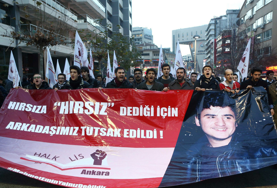 "Demonstrators hold a banner reading ""A friend was taken prisoner for calling a thief a thief"" and featuring a photo of 16-year-old Turkish teenager Mehmet Emin Altunses, who was released from jail on December 26 two days after his arrest, during a protest in Ankara on December 26, 2014. A Turkish court on December 26 freed a 16-year-old high school pupil arrested for ""insulting"" President Recep Tayyip Erdogan, amid accusations his detention was the latest sign of a lurch to authoritarianism under the strongman leader. The boy, Mehmet Emin Altunses, was released following a complaint by his lawyer, but he still faces trial in the future, the official Anatolia news agency reported."