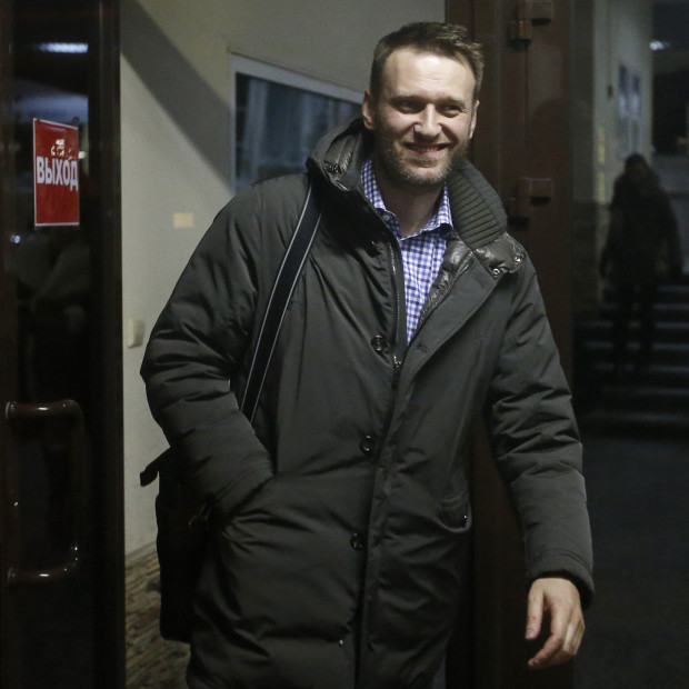 Opposition leader Alexei Navalny walks out after he visited a local broadcast radio station in Moscow January 14, 2015. Kremlin critic Alexei Navalny said on Jan. 5 he would no longer comply with the terms of his house arrest and had cut off his monitoring tag. Navalny, who led mass protests against Putin three years ago, was handed a suspended sentence on Dec. 30 after being found guilty of embezzling money in a trial which led to his brother being jailed on similar charges. REUTERS/Maxim Zmeyev (RUSSIA - Tags: POLITICS CRIME LAW MEDIA) - RTR4LG6T