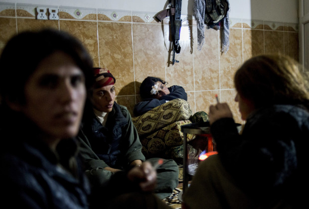 Female members members of the YJA Star, the military faction of the PKK, rest in the evening at their base near Sinjar Mountain, in Iraqi Kurdistan, March 6, 2015.