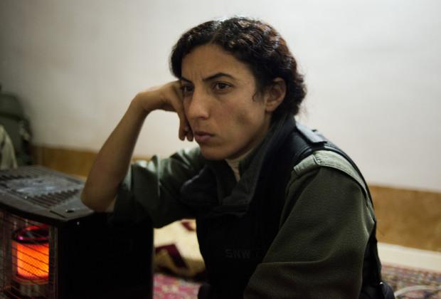 Beritan, second in command at her post near Sinjar Mountain listens during an interview in Iraqi Kurdistan, March 6, 2015.