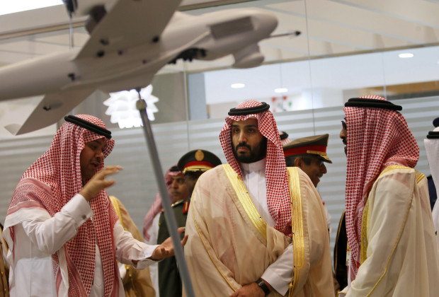 Saudi Defence Minister, Prince Mohammad bin Salman (C), visits the International Defence Exhibition and Conference (IDEX) in Abu Dhabi February 22, 2015. The event, which aims to showcase the latest technology in defence, runs from from February 22 to 26.  REUTERS/Stringer (UNITED ARAB EMIRATES - Tags: MILITARY SOCIETY ROYALS POLITICS) - RTR4QLQH