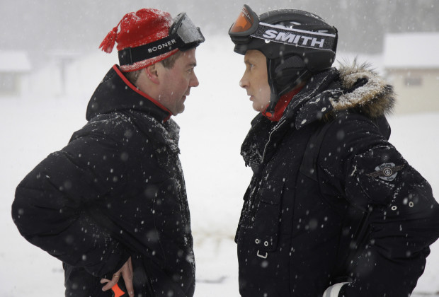 Russian President Dmitry Medvedev (L) and Prime Minister Vladimir Putin talk at Russia's ski resort Krasnaya Polyana near Sochi in southern Russia, January 3, 2010. Picture taken January 3, 2010.  REUTERS/RIA Novosti/Kremlin/Dmitry Astakhov  (RUSSIA - Tags: POLITICS SPORT) - RTR28IP9