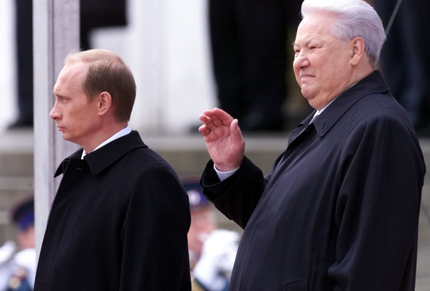 The first Russian president Boris Yeltsin (R) waves as President Vladimir Putin looks on during the inauguration ceremony in the Kremlin May 7. Putin was inaugurated as Russian president on Sunday in a brief, solemn Kremlin ceremony in which he vowed to unite nation, repay people's trust and learn from Russia's history.  CVI - RTR3UYX