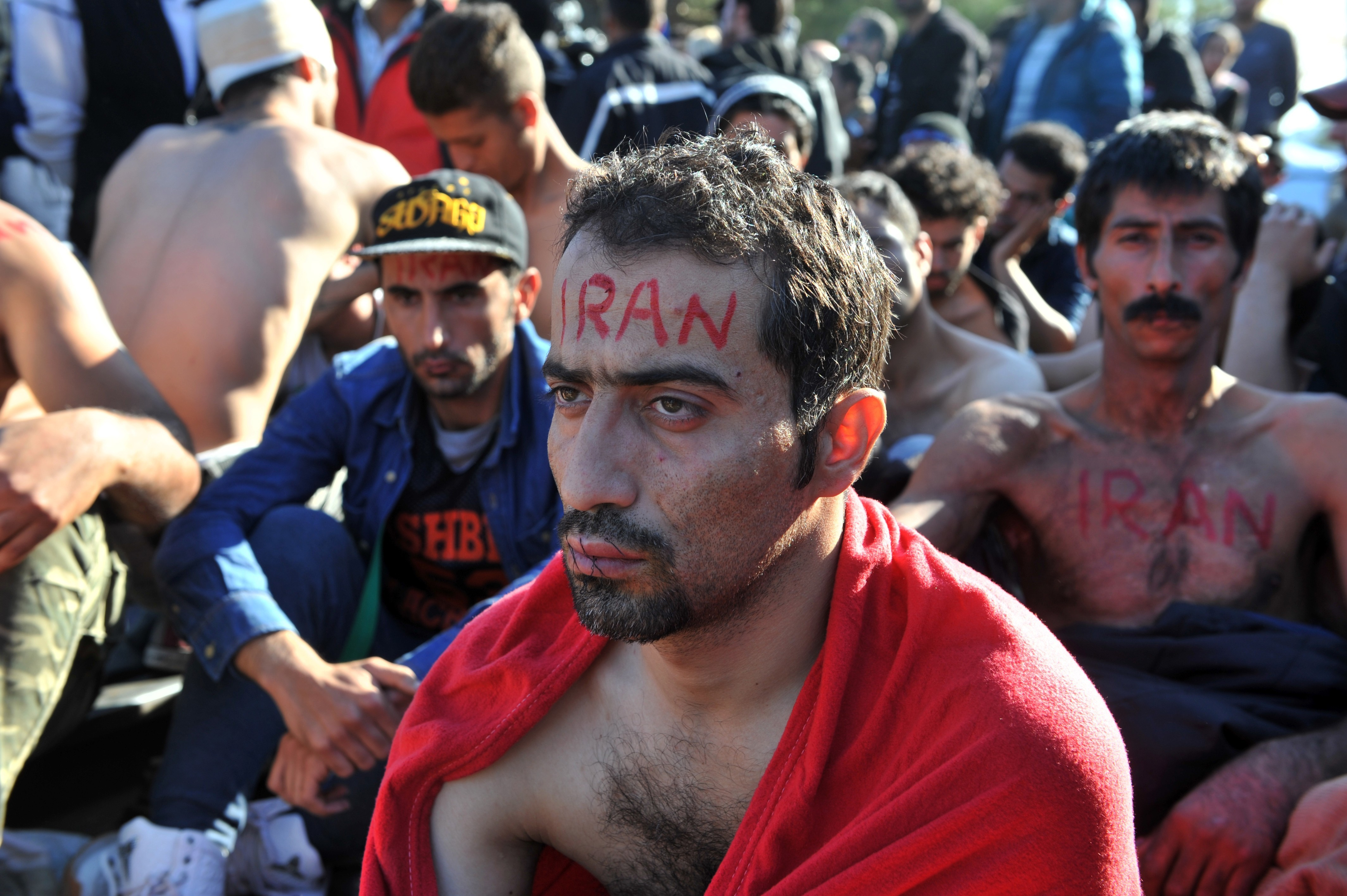 A man from Iran with his mouth sewn shut takes part in a demonstration with fellow migrants and refugees as they wait to cross the border of Greece and Macedonia (also referred as Former Yogaslavia Rebublic of Makedonia) near Idomeni on November 23, 2015. Serbia and Macedonia, which lie on the main migrant route to northern Europe, have begun restricting the entry of refugees to just those from certain countries, the UN refugee agency said. AFP PHOTO / SAKIS MITROLIDIS / AFP / SAKIS MITROLIDIS        (Photo credit should read SAKIS MITROLIDIS/AFP/Getty Images)