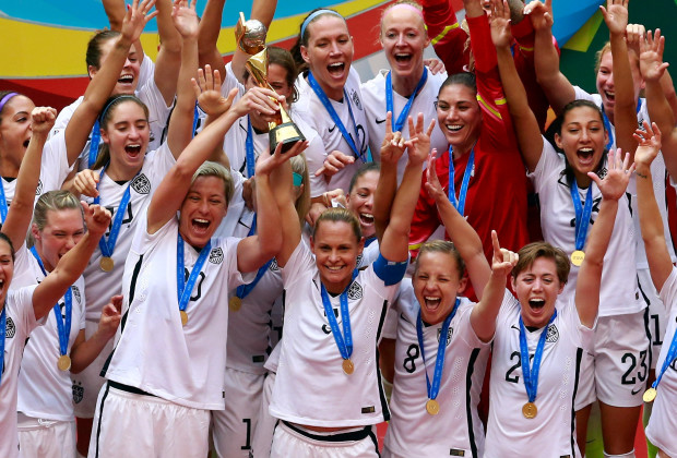 VANCOUVER, BC - JULY 05:  Abby Wambach #20 and Christie Rampone #3 of the United States celebrates after winning the FIFA Women's World Cup Canada 2015 5-2 against Japan at BC Place Stadium on July 5, 2015 in Vancouver, Canada.  (Photo by Jeff Vinnick/Getty Images)