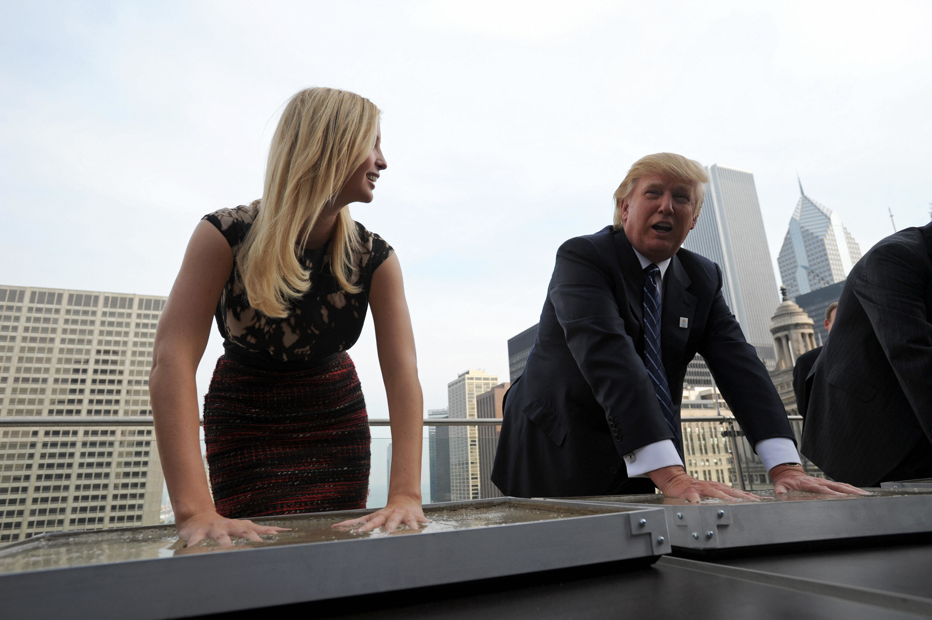 Real estate developer Donald Trump and his daughte Ivanka make hand prints during a press conference at the Trump International Hotel and Tower in Chicago on September 24, 2008. Trump's 1,360-foot (414.5-meter), 92-story tower is expected to be finished in six months and will stand as the second-tallest building in Chicago, after the Sears Tower.     AFP PHOTO/Amanda Rivkin (Photo credit should read Amanda Rivkin/AFP/Getty Images)