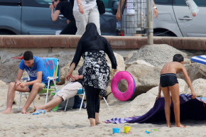 French Official Threatens Lawsuit For Sharing Burkini Cop Photos