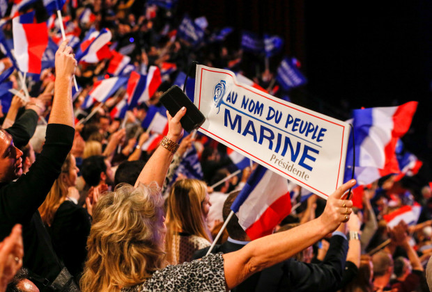 People cheer as Marine Le Pen, French National Front (FN) political party leader and candidate for the French 2017 presidential election, attends the 2-day FN political rally to launch the presidential campaign in Lyon, France February 5, 2017. REUTERS//Robert Pratta - RTX2ZPGC