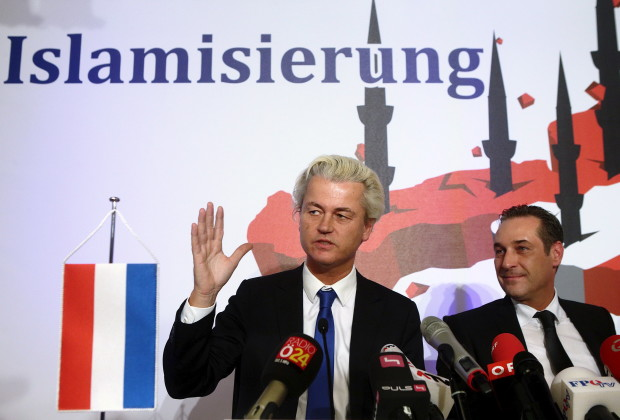"Dutch anti-Islam politician Geert Wilders (L) and head of the Austrian Freedom Party (FPOe) Heinz-Christian Strache address a news conference in Vienna March 27, 2015. Wilders rubbed shoulders with Strache in Vienna's parliament on Friday, with both saying they hoped to form a bloc in the European parliament in future. Text on the poster reads ""Islamisation"". REUTERS/Heinz-Peter Bader - RTR4V5Z7"