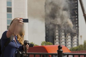 Tourists Take Selfies At Site Of Grenfell Tower Tragedy