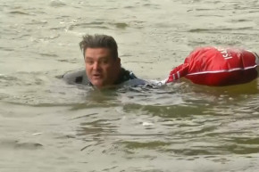 German Man Swims To Work To Avoid Crowds