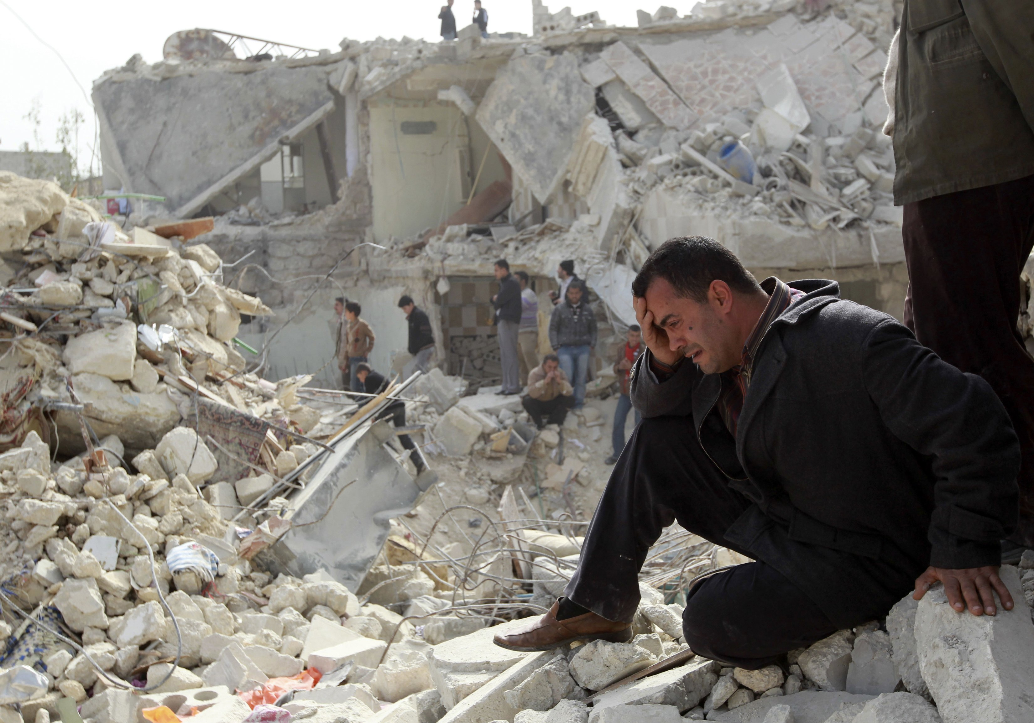 File photo of a man crying in Aleppo