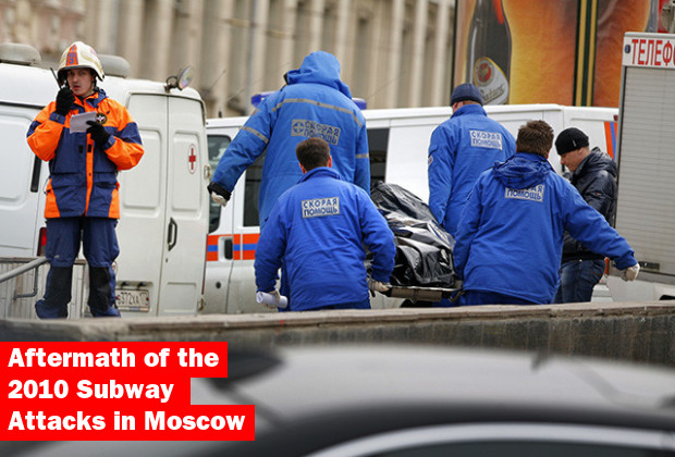 29 Mar 2010, Moscow, Russia --- Paramedics a stretcher bearing a subway blast victim into an ambulance at the cordoned off empty Lubyanka Square near the Lubyanka Subway station, not seen, which was earlier hit by an explosion, in Moscow, Monday, March 29, 2010. Two explosions blasted Moscow's subway system Monday morning as it was jam-packed with rush-hour passengers, killing many people, emergency officials and news agencies said. (AP Photo/Pavel Golivkin) --- Image by © Pavel Golivkin/AP/Corbis
