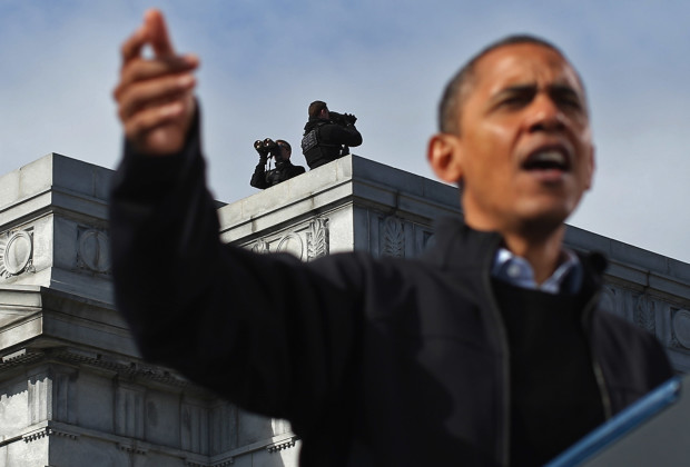 """U.S. President Barack Obama addresses a campaign rally in State Capitol Square November 4, 2012 in Concord, New Hampshire. With only two days left in the presidential election, Obama and his opponent, former Massachusetts Gov. Mitt Romney are stumping from one """"swing state"""" to the next in a last-minute rush to persuade undecided voters."""