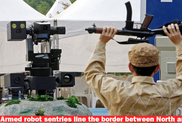 CHEONAN, REPUBLIC OF KOREA:  A sentry robot freezes a hypothetical intruder by pointing its machine gun during its test in Cheonan, 92 kms south of Seoul, 28 September 2006. South Korea unveiled a high-tech, machine gun-toting sentry robot that could support its troops in detecting and killing intruders along the heavily fortified border with North Korea.  The weapons-grade robot can detect, raise the alarm and provide suppressive fire, said Lee Jae-Hoon, deputy minister of commerce, industry and energy.    AFP PHOTO/KIM DONG-JOO    (Photo credit should read KIM DONG-JOO/AFP/Getty Images)
