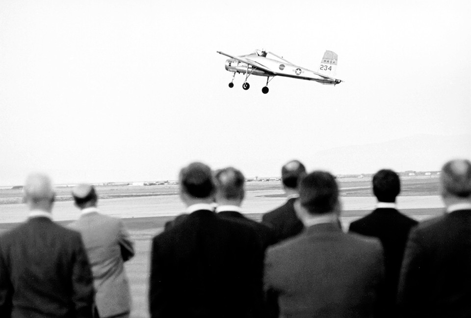 A demonstration of a vertical landing by the NASA Ames Research Center's Bell X-14A Vertical Take-off and Landing (VTOL) aircraft. Vanes in the jet exhaust pipe are then turned to deflect the jet exhaust downward allowing the aircraft to descend vertically to a soft landing.