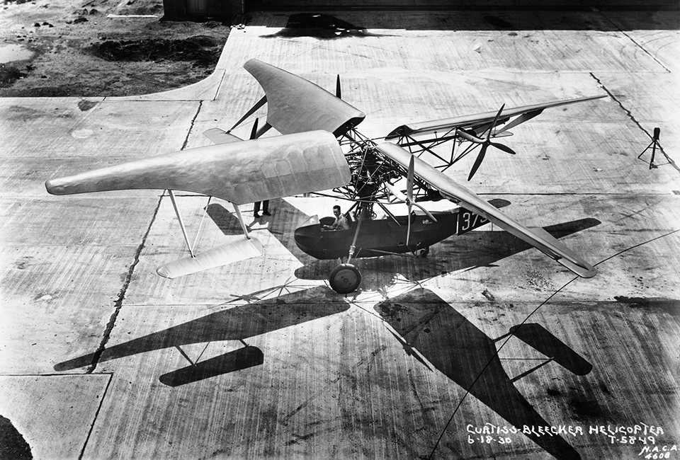 In June of 1930 this Curtiss Bleeker Helicopter was photographed on the tarmac in front of the Langley hangar. The first successful helicopters, however, appeared in Europe later in the decade.