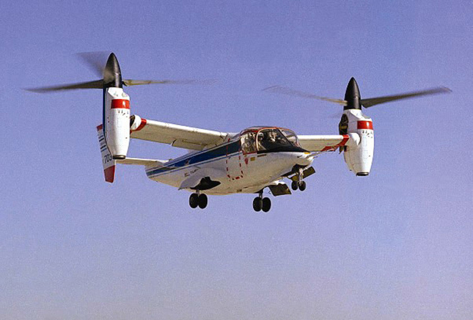 "The NASA-Army-Bell XV-15 tiltrotor research aircraft hovered (1976) and then demonstrated conversion and forward flight (1978) as the first tilting rotor vehicle to solve the problems of ""prop whirl."" Through tremendously difficult research, the tilt rotor aircraft was able to combine the advantages of vertical liftoff and landing capabilities, which are inherent to the traditional helicopter, with the forward speed and range of a fixed wing turboprop airplane. This research can eventually lead to providing the aviation transportation industry with the flexibility for high-speed, long-range flight, united with runway-independent operations, thereby significantly relieving airport congestion. The research success so far has directly led to the V-22 Osprey development. For more information, please see NASA History Monograph 17, The History of the XV-15 Tilt Rotor Research Aircraft:From Concept to Flight by Martin Maisel."