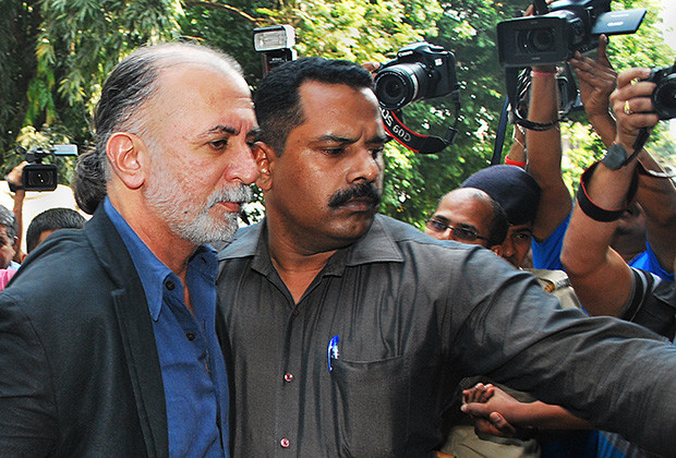 Indian magazine editor, Tarun Tejpal, is escorted by police officials from a courthouse after being remanded in police custody in Panaji on December 1, 2013. The editor of Indian news magazine Tehelka was remanded in custody after appearing in court on allegations of sexually assaulting a colleague in a hotel in the holiday state of Goa. A court in Goa ordered Tejpal remain in custody to allow police time to question the 50-year-old editor, who faces a possible rape charge over the allegations that could see him in jail for 10 years.        (Photo credit should read STRDEL/AFP/Getty Images)