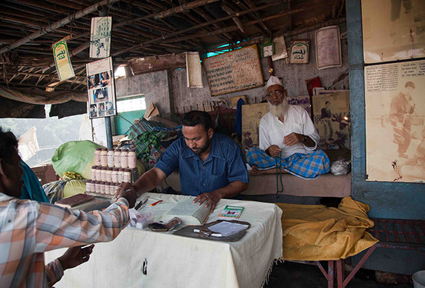 New Delhi: India: 2013    Mohammad Gyas has had patients from as far as the US and Japan. He collects and decorates his office with pictures, business cards and newspaper clippings of all those who have visited.