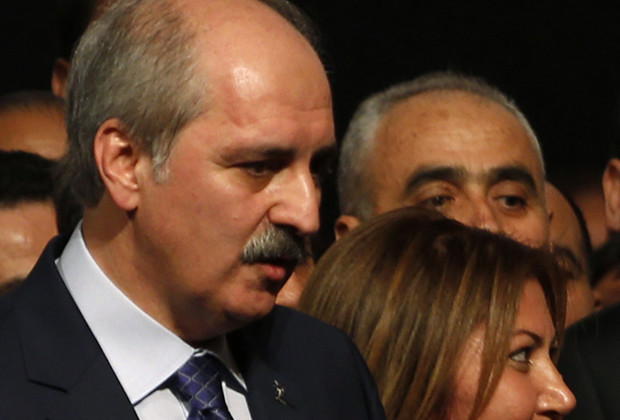 Turkey's Prime Minister and leader of Justice and Development Party (AKP) Tayyip Erdogan (C), accompanied by Numan Kurtulmus, head of the former Islamist-rooted HAS Party (L),  pose with the new members of his party during a party meeting in Istanbul September 22, 2012. The party's September 30, 2012 congress is unlikely to offer any sign Prime Minister Erdogan, viewed by many Turks as their strongest leader since Ataturk, is loosening his grip on a heavily-centralised party or on the country as a whole.  Picture taken September 22, 2012. To match story TURKEY-AKP/ REUTERS/Murad Sezer (TURKEY  - Tags: POLITICS) - RTR38FI0