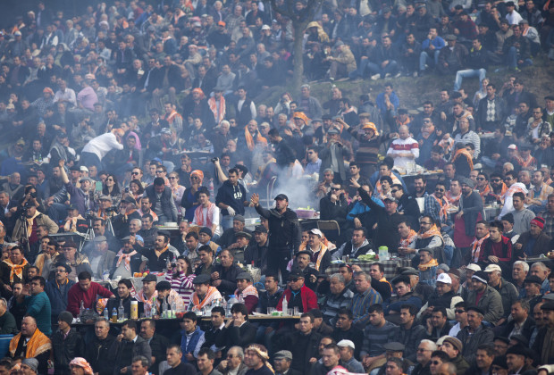 Through a thick cloud of barbecue smoke, fans react after a match is called during the Selcuk Efes Camel Wrestling Festival.  Photo by Jodi Hilton/Vocativ