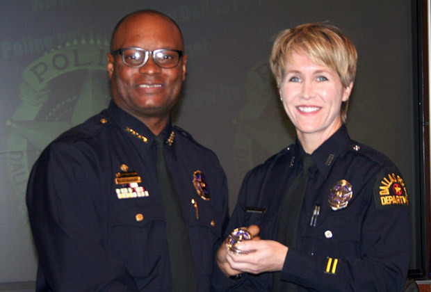 Officer Laura Martin, LGBT Liaison Officer for the DPD, receives her promotion badge from Police Chief David Brown in December 12, 2011.