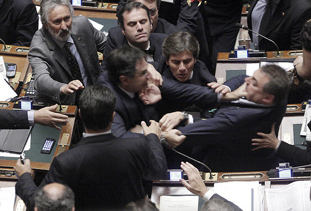 Claudio Barbato (L), a member of the opposition FLI party, fights with Fabio Ranieri (R) from the Northern League in Parliament in Rome October 26, 2011. The Italian deputies exchanged blows in parliament on Wednesday as tensions over a tough economic reform programme came to a head.  REUTERS/Ansa/Giuseppe Lami   (ITALY - Tags: POLITICS TPX IMAGES OF THE DAY) FOR EDITORIAL USE ONLY. NOT FOR SALE FOR MARKETING OR ADVERTISING CAMPAIGNS. THIS IMAGE HAS BEEN SUPPLIED BY A THIRD PARTY. IT IS DISTRIBUTED, EXACTLY AS RECEIVED BY REUTERS, AS A SERVICE TO CLIENTS. ITALY OUT. NO COMMERCIAL OR EDITORIAL SALES IN ITALY - RTR2T7S9