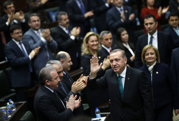 Turkey's Prime Minister Tayyip Erdogan greets his supporters as he arrives for a meeting at the parliament in Ankara January 14, 2014. Erdogan looks to have the upper hand in a civil war rocking Turkey's political establishment, but his bid to break the influence of a potent Islamic cleric could roll back reforms and undermine hard-won business confidence. What erupted a month ago as a damaging inquiry into alleged government corruption has spiralled into a battle over the judiciary with potentially much further-reaching consequences for the country's international image and Erdogan's own future. REUTERS/Umit Bektas (TURKEY - Tags: POLITICS) - RTX17DO0