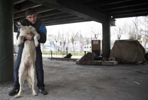 Agit with one of several dogs he and his fellow drug users keep with them at their camp under a bridge in Istanbul. PHOTO BY JODI HILTON
